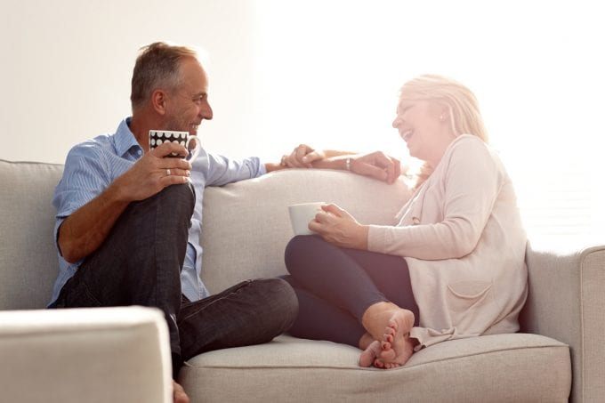 Mature couple spending free time together at home